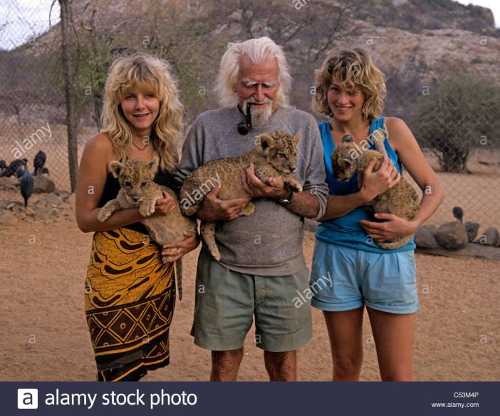 george-adamson-with-doddi-carla-holding-young-lion-cubs-at-kora-rock-C53M4P