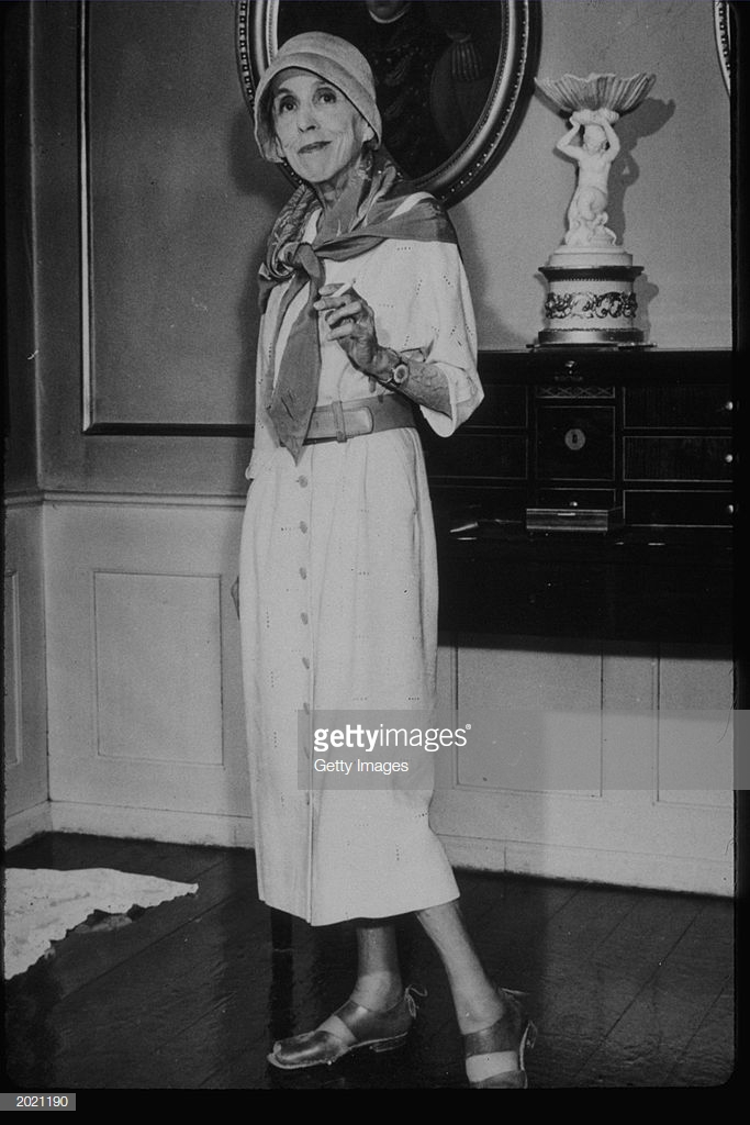 Isak Dinesen Stands With Cigarette